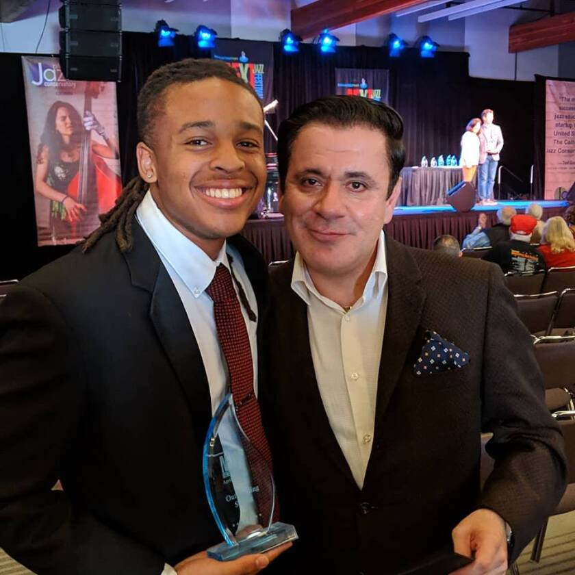 Alvin Paige, who plays tenor sax, is with his instructor and mentor Gilbert Castellanos at the Monterey Jazz Festival's Next Generation awards. A junior at the San Diego School of Creative and Performing Arts, Paige took home the trophy for outstanding tenor sax soloist.