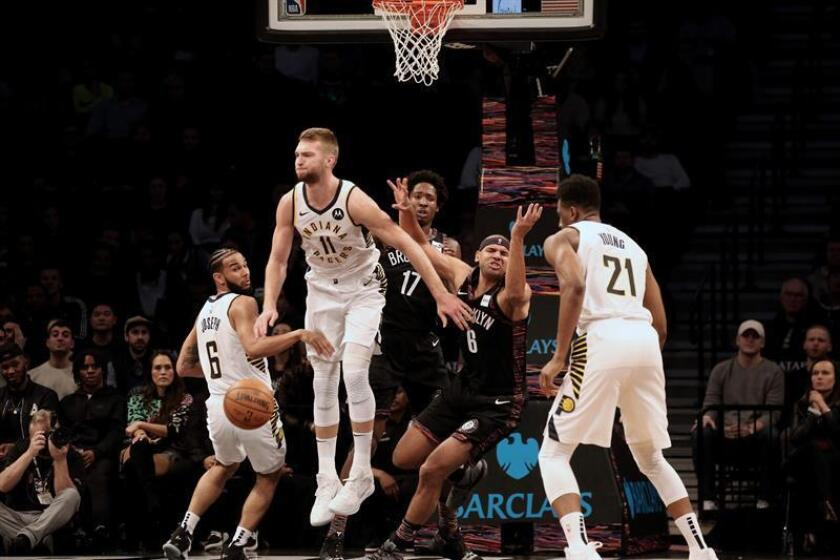 Brooklyn Nets forward Jared Dudley (C) loses the ball while being defended by Indiana Pacers forward Domantas Sabonis (L) during an NBA game between the Indiana Pacers and the Nets at Barclays Center in Brooklyn, New York, USA, on Dec. 21, 2018. EPA-EFE/PETER FOLEY