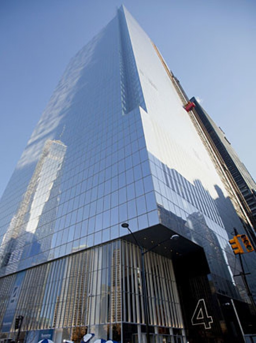 Pedestrians pass in front of the 4 World Trade Center building.