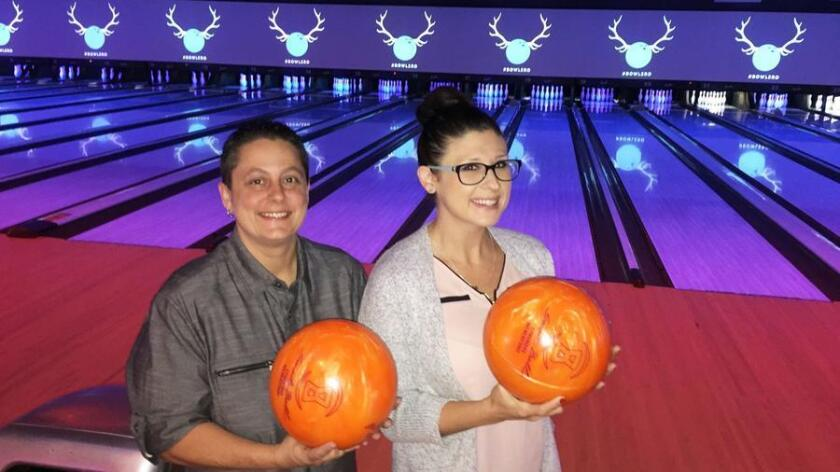 Jennifer Kraus, general manager of Bowlero San Marcos, left and Krystle Grampre, Bowlmor AMF area manager, inside the newly renovated San Marcos bowling alley that hosts its grand opening on Saturday, Oct. 14. (Pam Kragen/San Diego Union-Tribune)