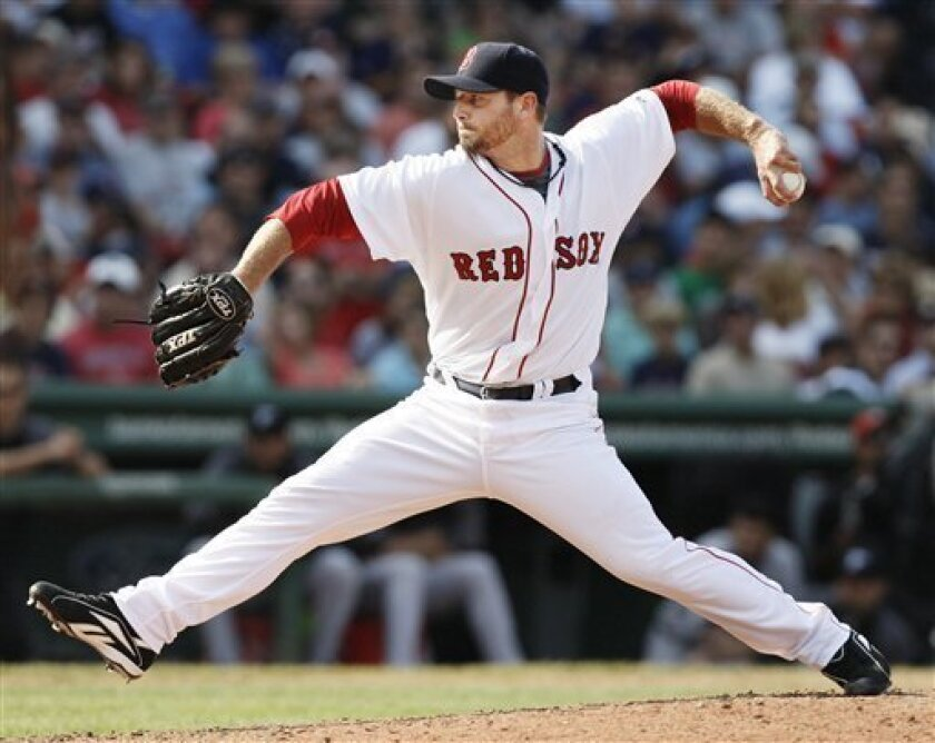 FILE - This is an Aug. 30, 2009, file photo showing Boston Red Sox pitcher Billy Wagner during his first appearance for the Red Sox in their 7-0 win over the Toronto Blue Jays in a baseball game at Fenway Park in Boston. Wagner and the Atlanta Braves agreed Wednesday, Dec. 2, 2009, to a $7 million, one-year contract. (AP Photo/Winslow Townson, File)
