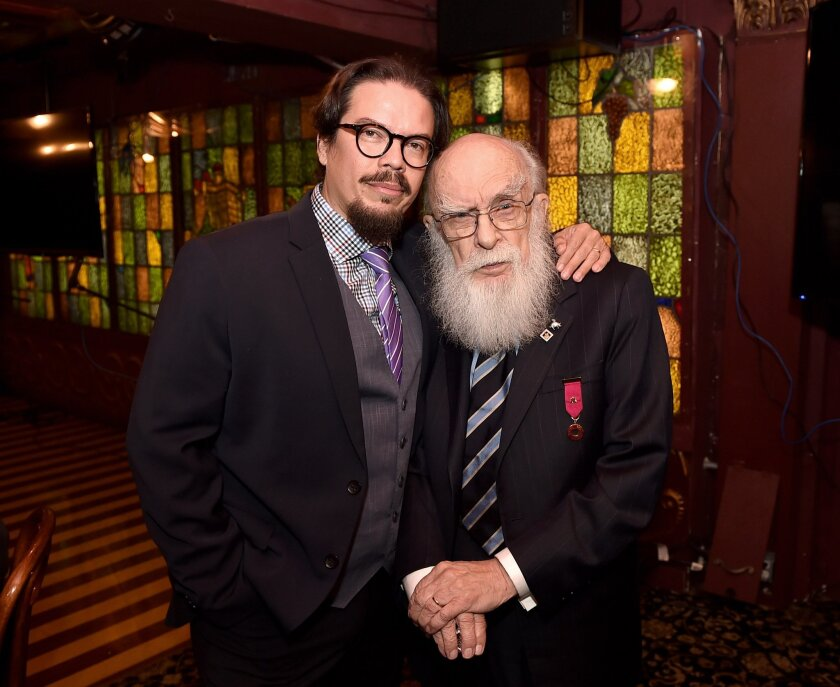 "Magician James Randi, right, with his husband, artist Deyvi Pena, at a screening of ""An Honest Liar."""