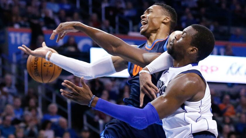 Dallas Mavericks forward Harrison Barnes knocks the ball away from Oklahoma City Thunder guard Russell Westbrook during the second half.