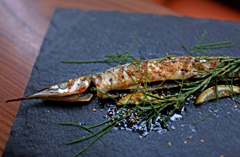Grilled needlefish is stuffed with rosemary sprigs from Orsa & Winston in downtown L.A.
