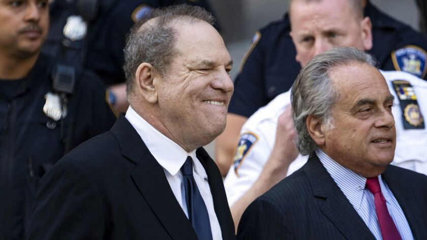 Harvey Weinstein, left, with his attorney Benjamin Brafman, right, leaves a Manhattan courthouse, Mo