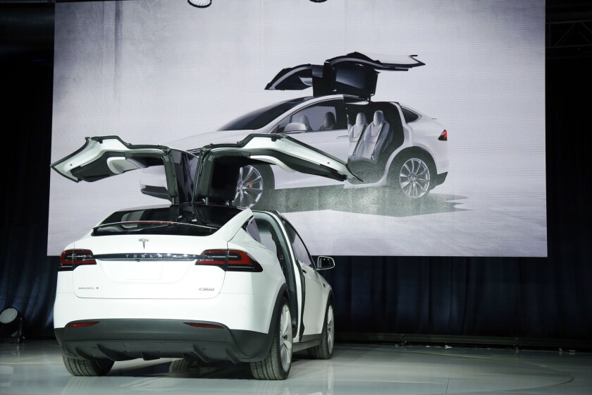 The Tesla Model X crossover, list price unknown, is unveiled Tuesday in Fremont, Calif.