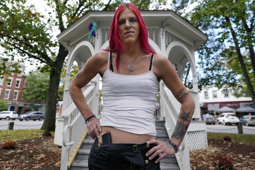 Aria DiMezzo, a Republican candidate for sheriff in Cheshire County, New Hampshire, poses at the Central Square gazebo, Tuesday, Oct. 6, 2020, in Keene, N.H. Republicans in the New Hampshire county are wrestling with the fact that DiMezzo, who was nominated in last month's primary, is a transgender satanist whose campaign slogan disparages the police. (AP Photo/Charles Krupa)