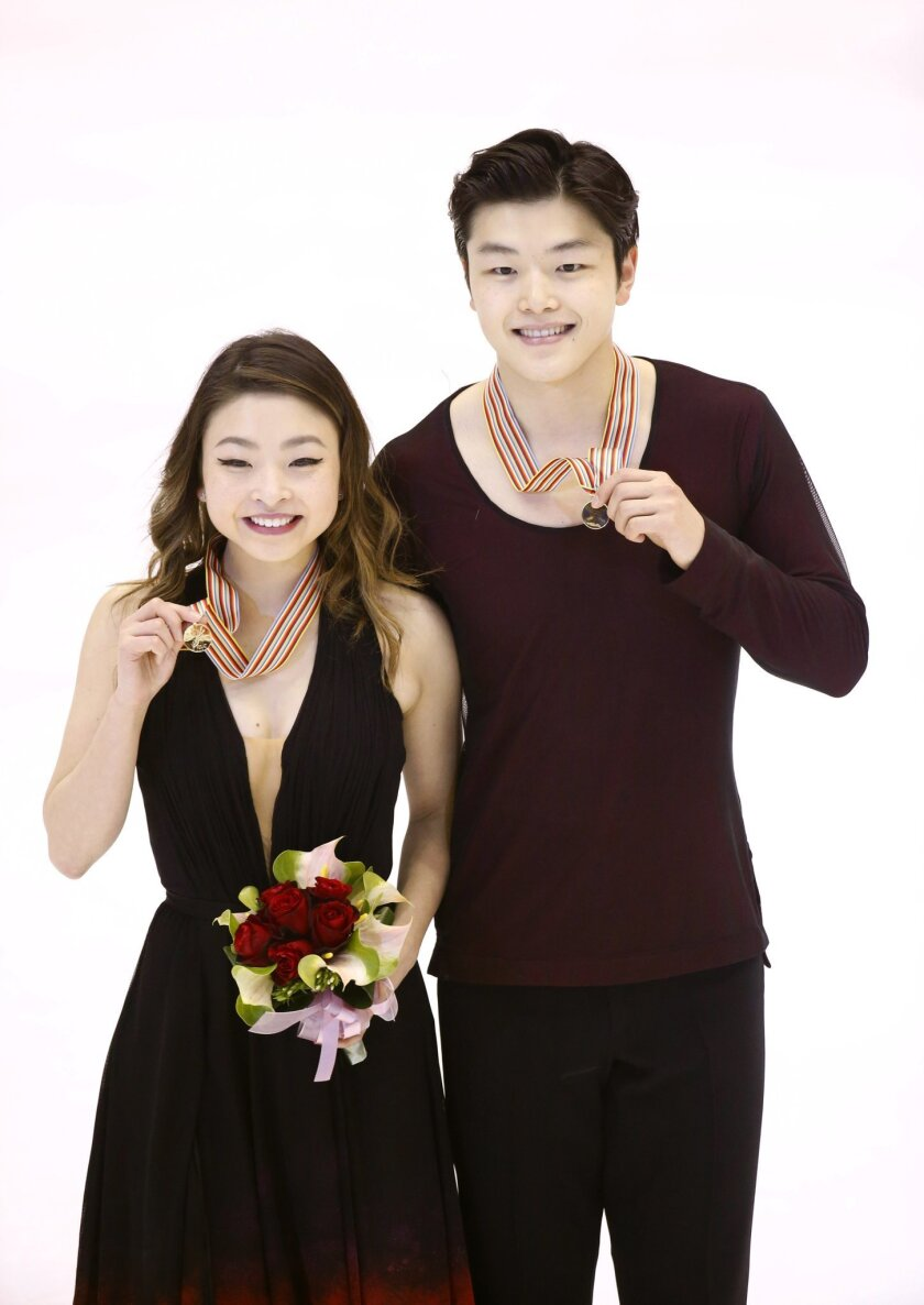 Winners Maia Shibutani and Alex Shibutani from the United States display their gold medals after competing in the Ice Dance Free Dance program at the Taiwan ISU Four Continents Figure Skating Championships in Taipei, Taiwan, Friday, Feb. 19, 2016. (AP Photo/Wally Santana)