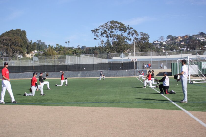 During tryouts, hopefuls warm up for a chance to play the 2016 season.