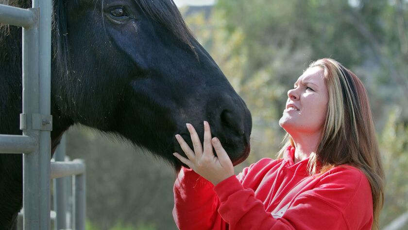 Michelle Cochran at her HiCaliber Horse Rescue in Valley Center.