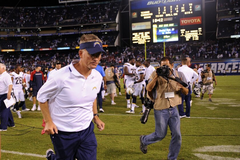Chargers head coach Mike McCoy runs off the field after the season-opening loss to the Houston Texans last year.