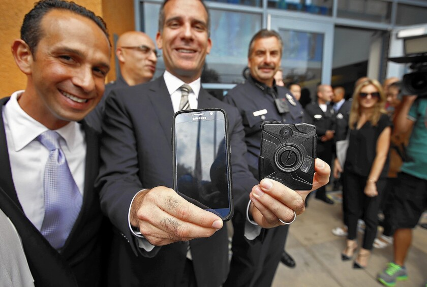 Councilman Mitch Englander, left, with Mayor Eric Garcetti, accepted campaign donations from Taser International executives. The firm is seeking an LAPD camera contract.
