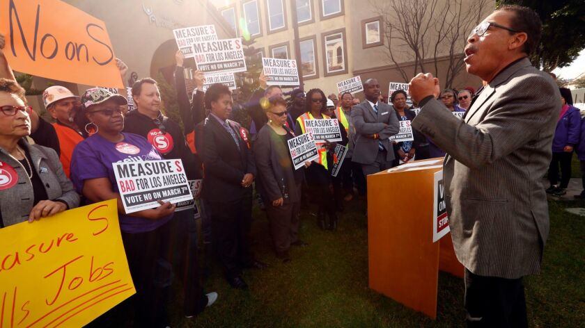 Residents and elected officials at an event urging voters to reject Measure S, which could freeze investment in South L.A.