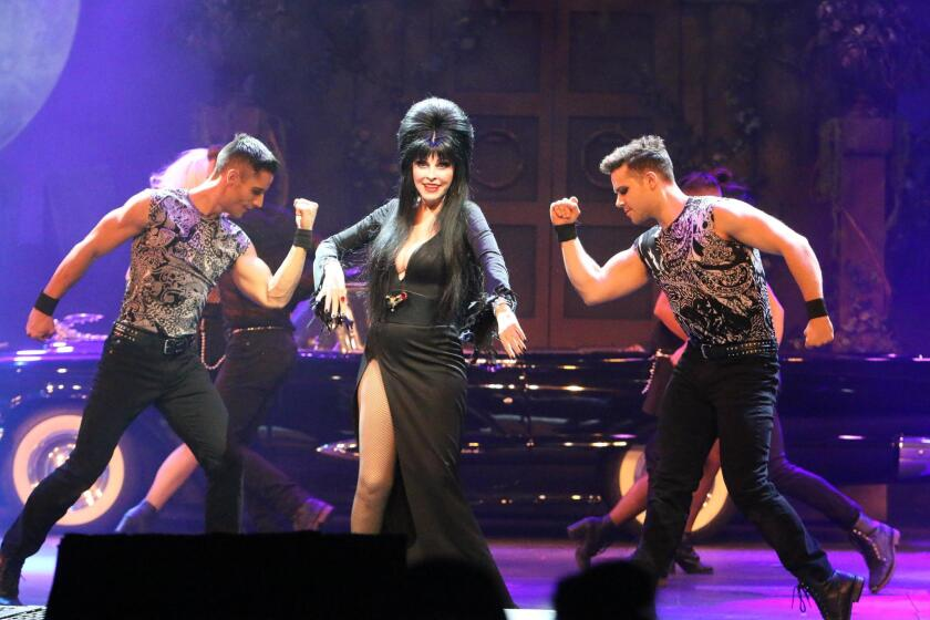 Elvira, Mistress of the Dark, performs a 'not scary,' Las Vegas-style stage show nightly at Knott's Scary Farm. 2017 is also her final year performing at Knott's.