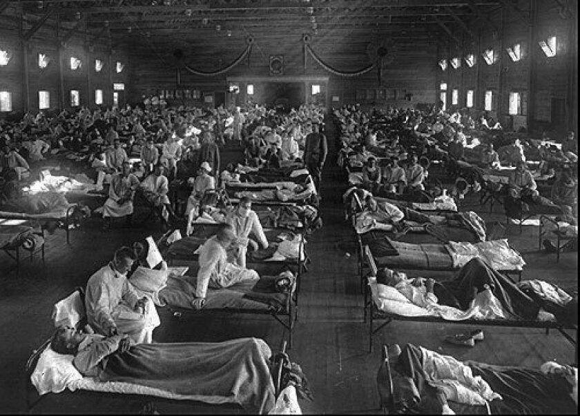 Patients crowd an emergency hospital near Ft. Riley, Kan., in 1918.