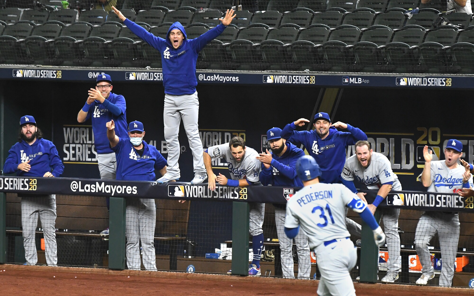 The Dodgers dugout erupts after a solo home run by Joc Pederson during the second inning in Game 5 of the World Series.