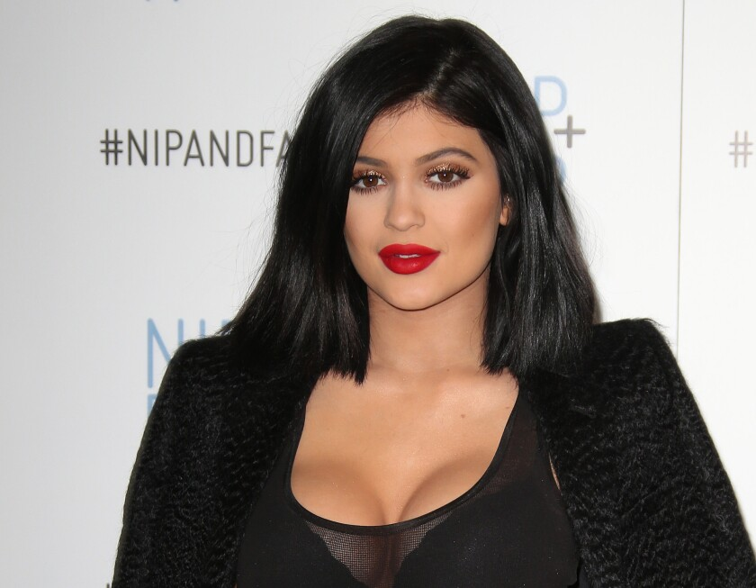 Reality star Kylie Jenner addresses the viral #KylieJennerChallenge. She is pictured promoting the skin care line Nip and Fab.
