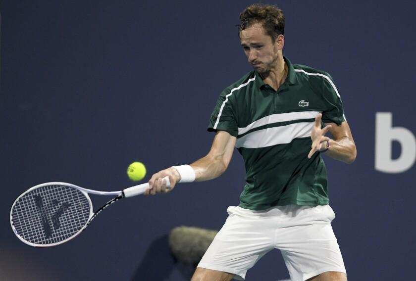 Daniil Medvedev, of Russia, returns to Roberto Bautista Agut, of Spain, during the Miami Open tennis tournament Wednesday March 31, 2021, in Miami Gardens, Fla. Bautista Agut won 6-4, 6-2. (AP Photo/Taimy Alvarez)