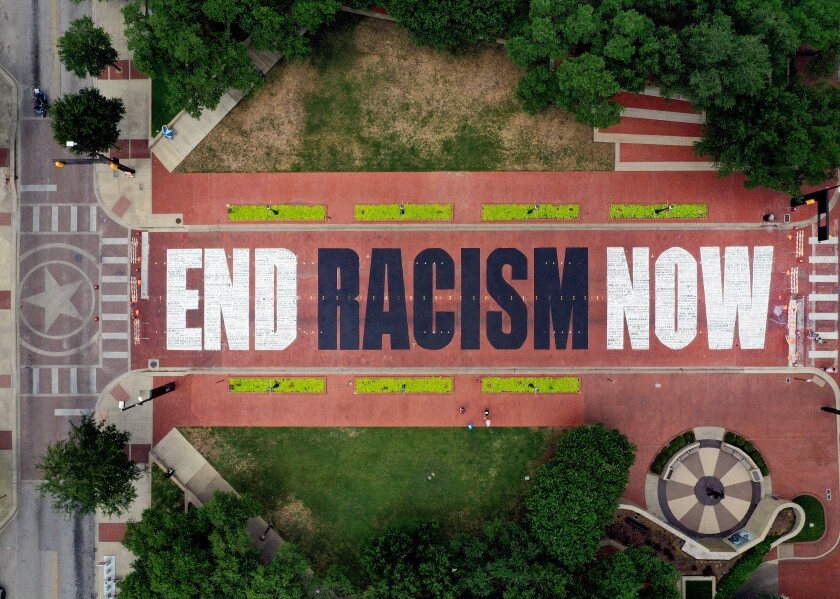 """An aerial view from a drone as residents view the """"End Racism Now"""" mural painted on Main Street in Fort Worth, Texas."""