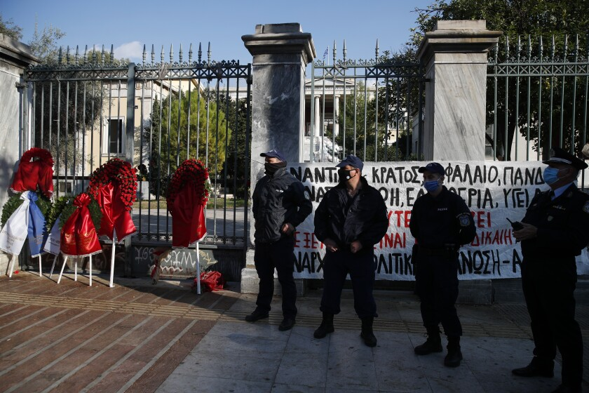 Police stand guard outside the Athens Polytechnic in the Greek capital on Monday, Nov. 16, 2020. The government has banned an annual rally to mark the anniversary of Nov. 17, 1973 uprising by Polytechnic students against the military dictatorship that then ruled the country and collapsed the following year. Left-wing opposition parties have criticized the decision taken due to the pandemic and vowed to defy the ban. (AP Photo/Thanassis Stavrakis)