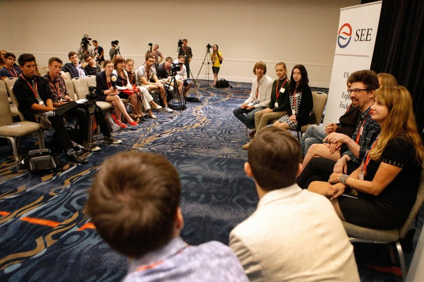 """Russian students and educators hold a mock press conference to address the importance of international collaboration in education at the United States-Russia Social Expertise Exchange Education & Youth """"Open Doors"""" Symposium and Student Television Network Convention Thursday."""