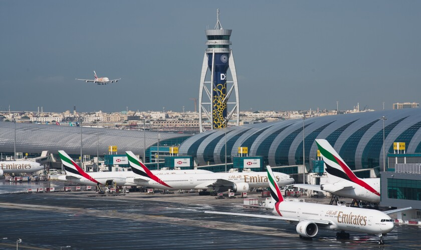 FILE - In this Dec. 11, 2019 file photo, an Emirates jetliner comes in for landing at Dubai International Airport in Dubai, United Arab Emirates. The airport is getting busier but it's a long way from what it once was amid the coronavirus pandemic. To boost those numbers, airport CEO Paul Griffiths is urging countries to move away from mandatory quarantines on arriving passengers and toward the strategy embraced by Dubai. That includes aggressive coronavirus testing before departure, followed by mandatory mask-wearing on aircraft. (AP Photo/Jon Gambrell, File)