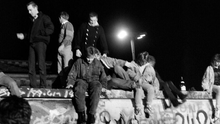 West Berliners climb on the Berlin Wall on Nov. 10, 1989.