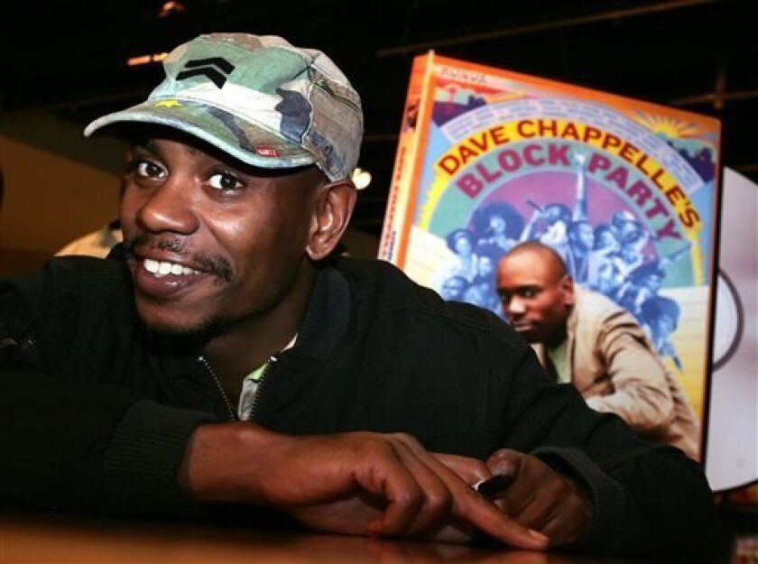 """FILE - In this June 13, 2006 file photo, comedian Dave Chappelle promotes the release of his new DVD """"Dave Chappelle's Block Party,"""" at the Virgin Megastore in Los Angeles. Chappelle has struck back at Hartford five days after he was heckled at a show and refused to perform his set. According to audio posted on TMZ.com, Chappelle praises an audience in Chicago on Tuesday for being """"so much better than Hartford."""" He tells the crowd that if North Korea were to drop a bomb on the U.S., he hopes it"""