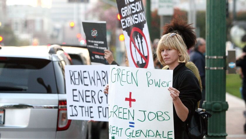 A Glendale resident writes in opposition of the Grayson Power Plant. Protesters hold signs to engage passing motorists at a rally on the steps of Glendale City Hall in February 2018 hosted by Glendale Environmental Coalition to oppose the plant's expansion.