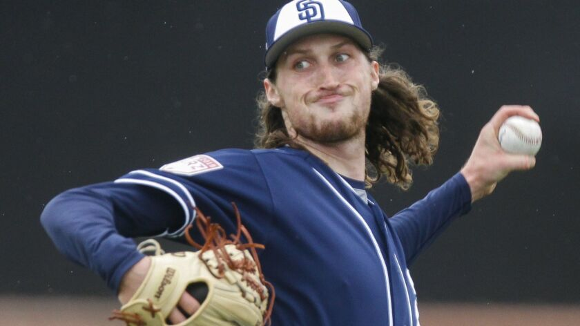 PEORIA, February 14, 2019 | Padres' pitcher Matt Strahm throws on the first official day of Padres s
