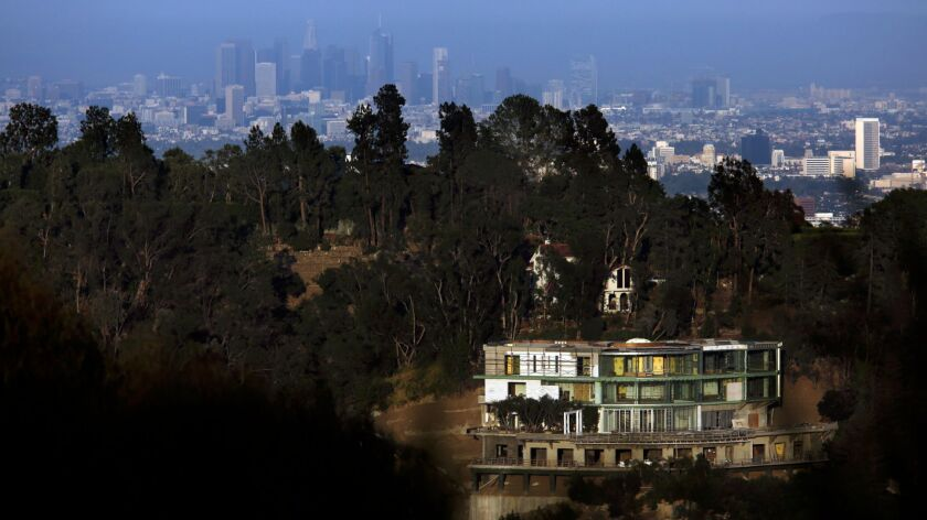 The unfinished mansion sits on Strada Vecchia Road in Bel-Air.