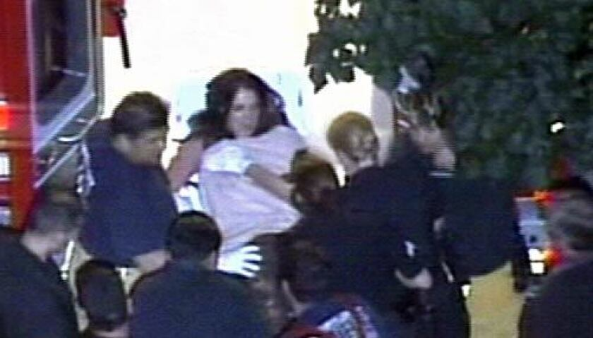 Britney Spears carried from her home