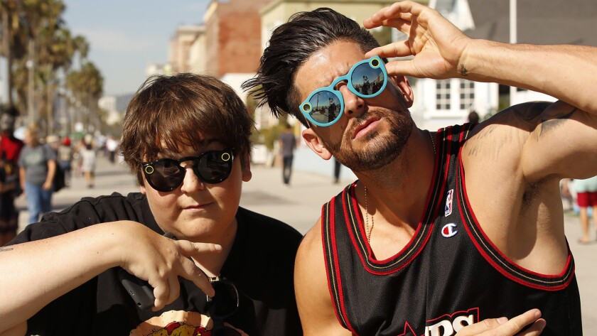 Actor-comedian Andy Milonakis, 40, left, and YouTube star Jesse Wellens, 34, try on their Snapchat Spectacles in Venice.