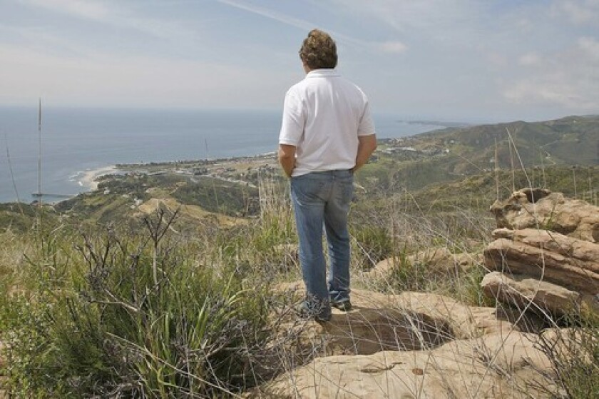 A Malibu resident takes in the view from the property owned by U2 guitarist David Evans, a.k.a. the Edge. Construction of five homes there would be an engineering feat.