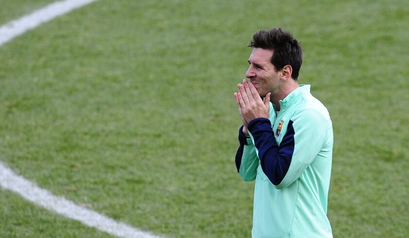 FC Barcelona's Lionel Messi, from Argentina, gestures during a training session at the Mini Stadi Stadium in Barcelona, Spain, Friday, Jan. 3, 2014. (AP Photo/Manu Fernandez)