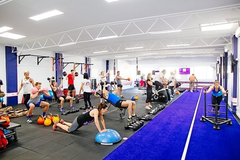 A F45 workout involves rotating to different stations, each with a unique series of exercises.