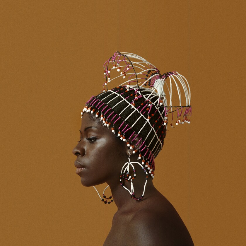 Sikolo Brathwaite wears a headdress by Carolee Prince in this image by Kwame Brathwaite from 1968.