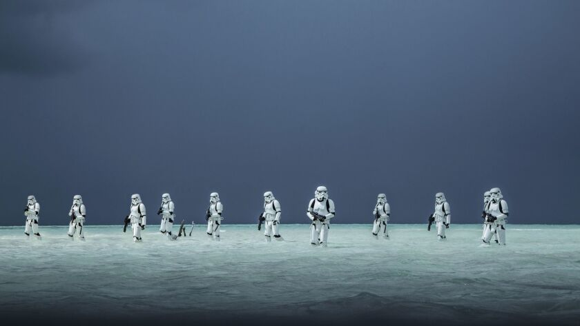 """Stormtroopers storm a beach in Buena Vista's """"Rogue One: A Star Wars Story,"""" which continues to sit atop the box office."""