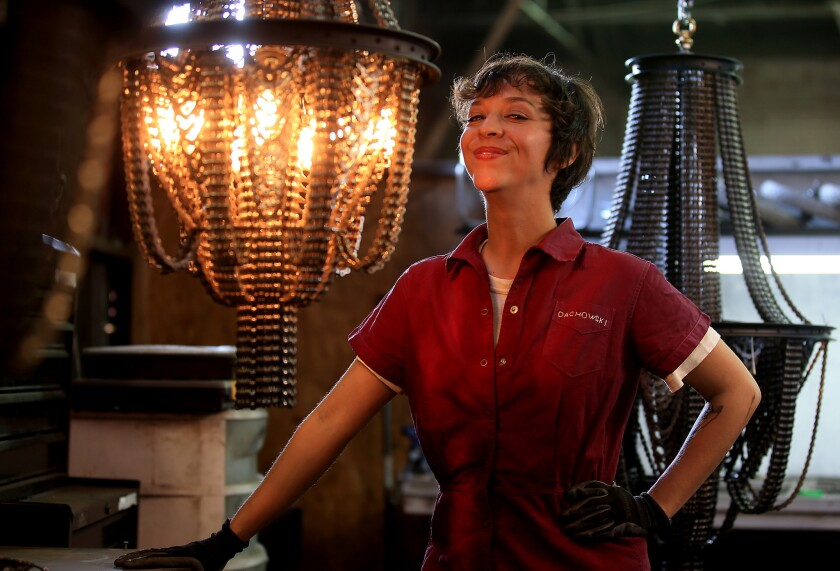 Artist Carolina Fontoura Alzaga makes chandeliers from old bicycle parts, including chains, sprockets and spoked wheels. Her company, Facaro, ships the custom-made light fixtures all over the world.