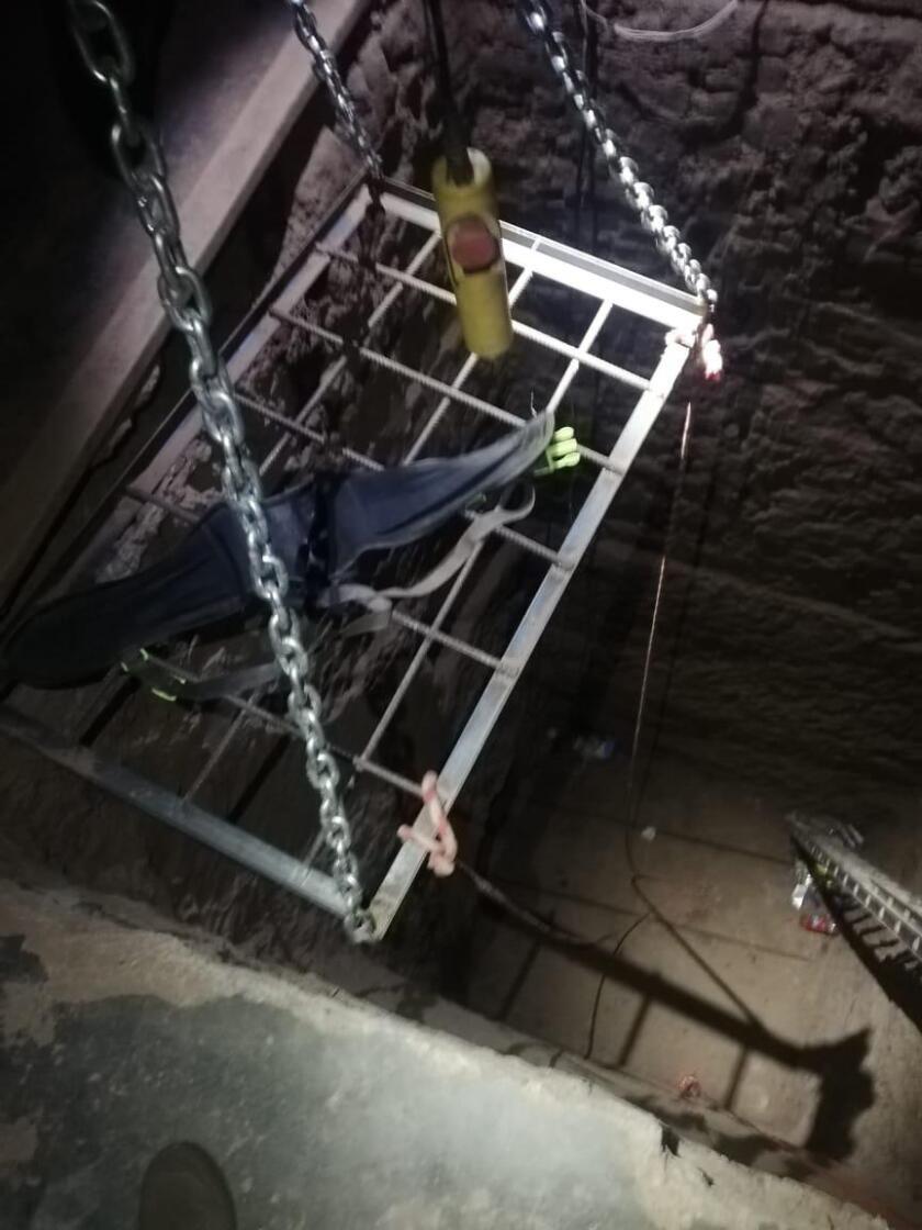 A  subterranean tunnel in Mexicali shows an electric hoist