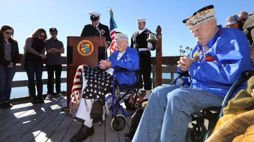 Pearl Harbor veterans John Quier, 98, left, and Joe Walsh, 99, right, at the Pearl Harbor memorial ceremony at Oceanside Harbor on Dec. 7, 2018.