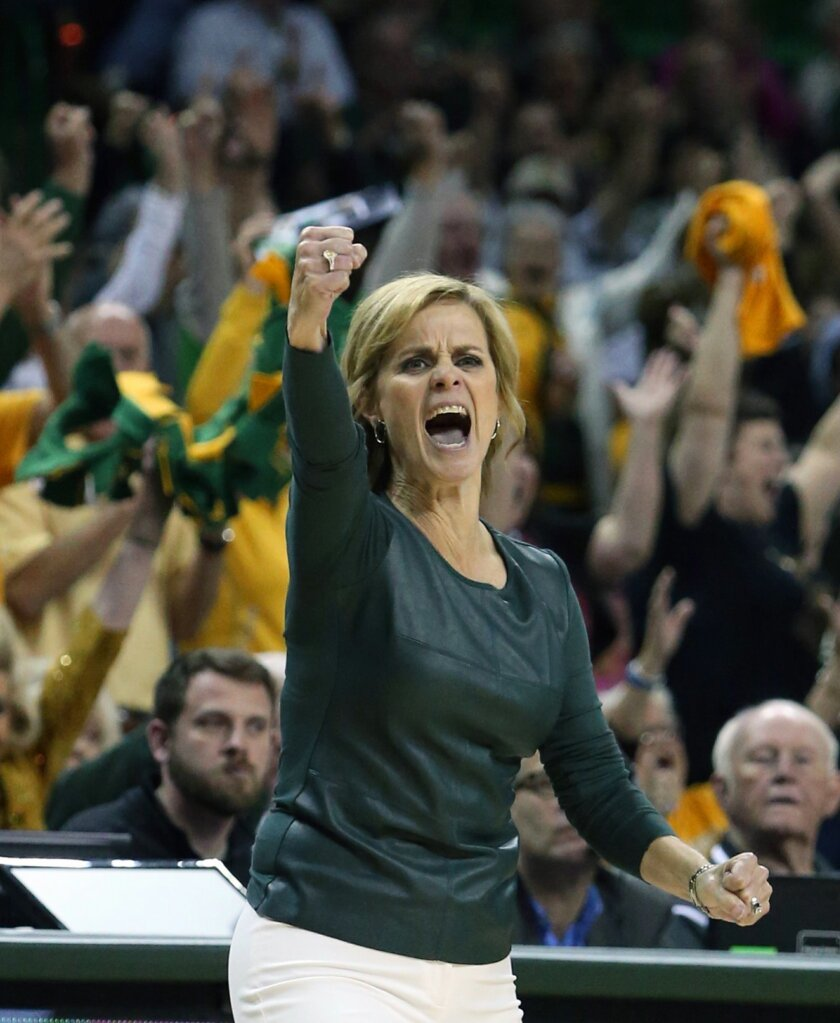 FILE - In this Feb. 17, 2016, file photo, Baylor head coach Kim Mulkey reacts to a play against Oklahoma State in the second half of an NCAA college basketball game, in Waco, Texas. While under the radar nationally, even with two national championships under coach Kim Mulkey, the No. 4 Lady Bears a