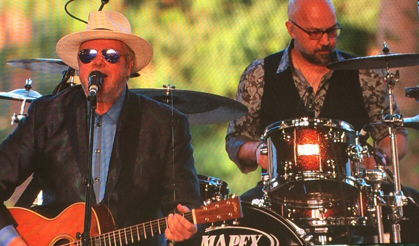 Texas singer-songwriter Robert Earl Keen, left,performs on Friday's opening day of the three-day Stagecoach Country Music Festival in Indio.
