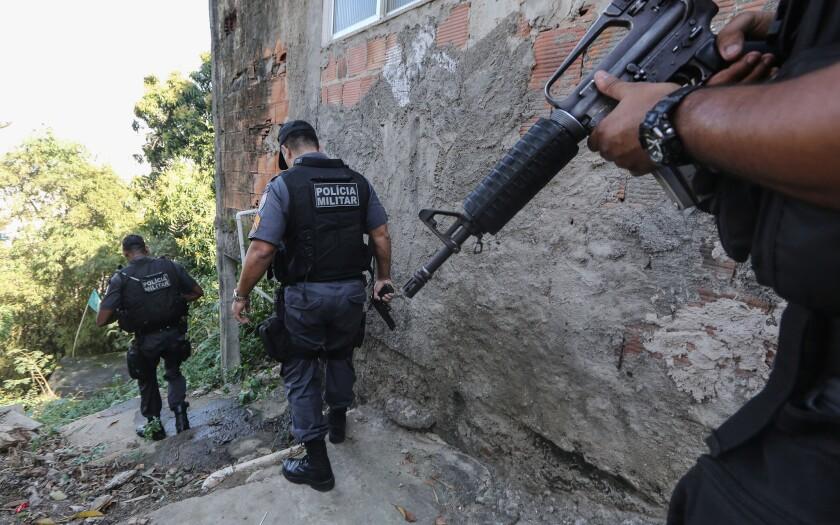Police patrol favela