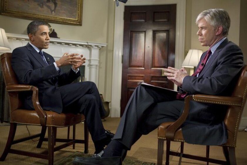 David Gregory is seen interviewing President Obama in 2009.