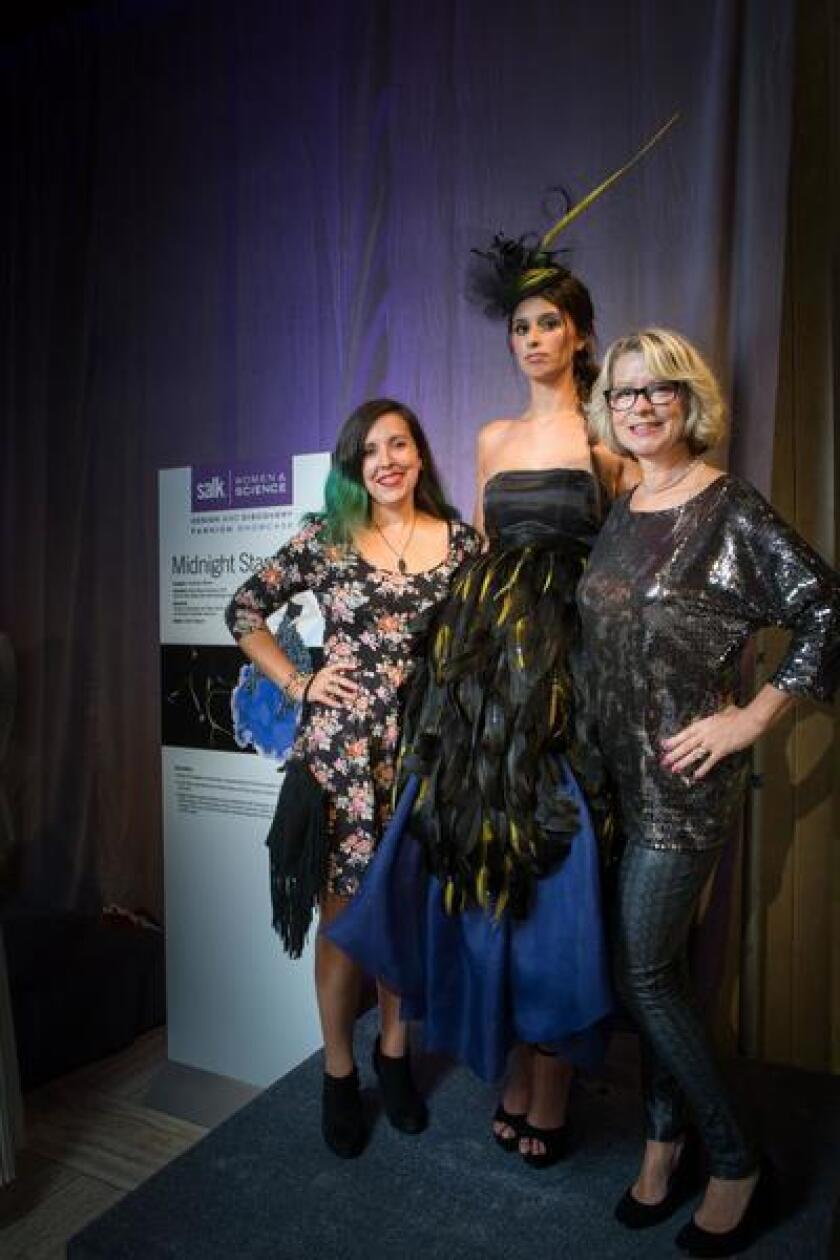 Salk Institute's Women & Science Design and Discovery Fashion Showcase 2017: Scientist Elena Blanco-Suarez, model Caitlin Magner and designer Christiann Moore with 'Midnight Stars,' representing a study of astrocytes and their role in making healthy connections between neurons.