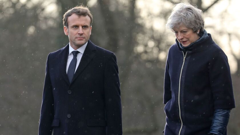 French President Emmanuel Macron and British Prime Minister Theresa May attend a ceremony at the Royal Military Academy Sandhurst, west of London on Thursday.