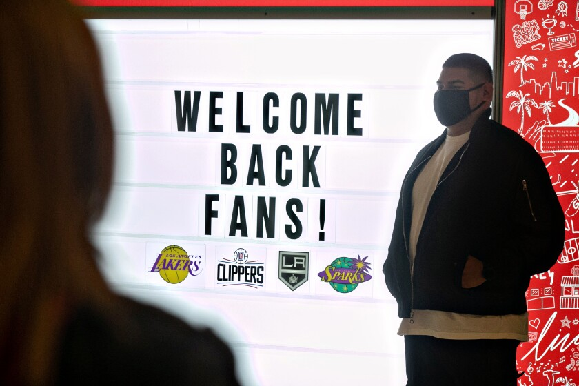Staples Center staff prepare for fans to return to the arena for the Lakers-Celtics game on Thursday.