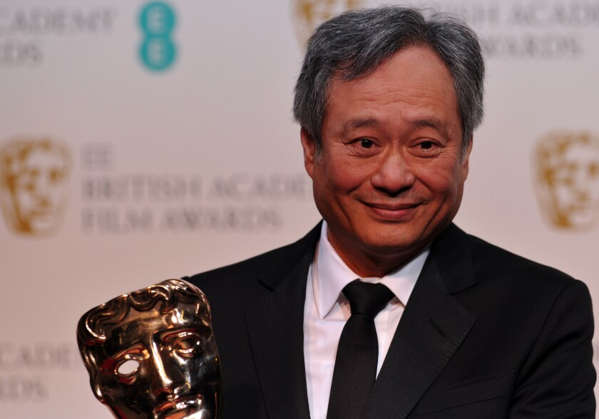 """Ang Lee picks up the cinematography award for Claudio Miranda for his work on """"Life of Pi"""" at the British Academy of Film and Television Arts Awards in London."""