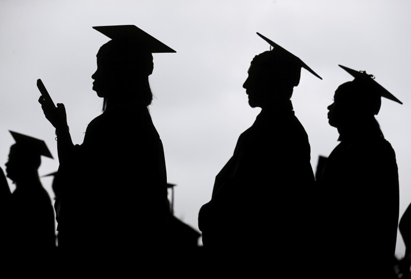 """FILE - In this Thursday, May 17, 2018 file photo, new graduates line up before the start of a community college commencement in East Rutherford, N.J. Scholarship search websites promise students access to millions of awards totaling billions in free money for college. But once you provide your email address, scholarship listings aren't the only things you'll receive. """"[You] are going to get a lot of spam,"""" says Monica Matthews, creator of the website how2winscholarships.com. """"You are going to be inundated."""" (AP Photo/Seth Wenig)"""